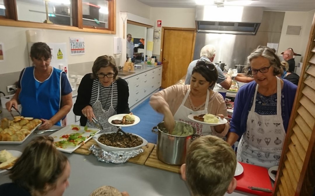 Rotarians lend a hand at the Community Meal
